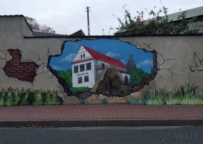 wykonany mural - dziura w murze